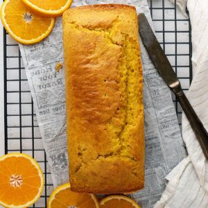 orange cake loaf on a cooling rack