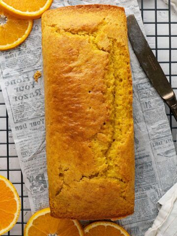 orange cake loaf on a cooling rack