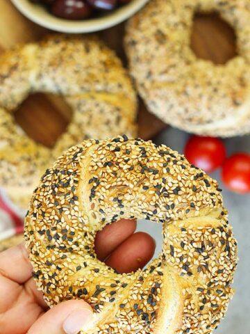 Holding Turkish Sesame Bread Simit