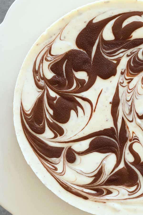 top view of no bake stracciatella cheesecake showing swirl chocolate decoration