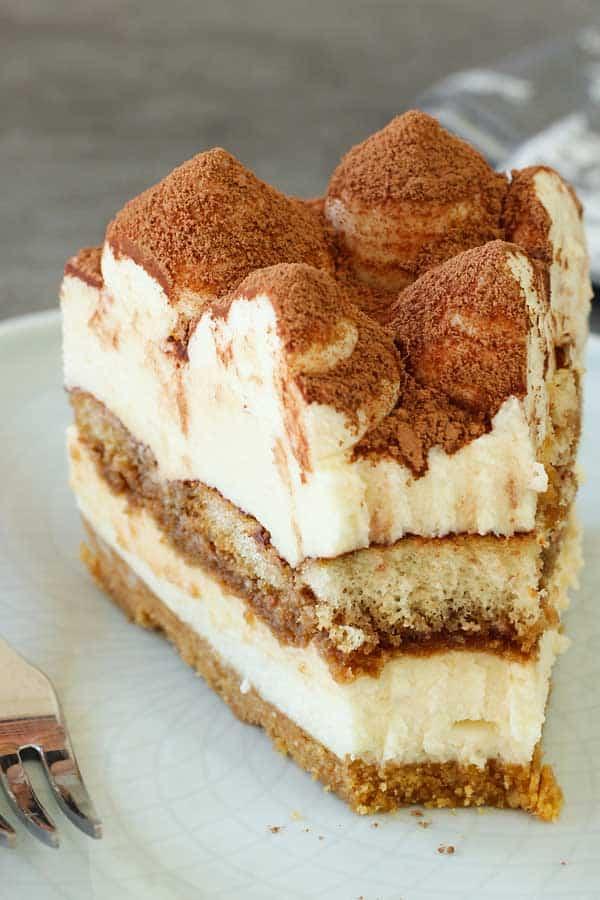 No bake tiramisu cheesecake portion missing a bite
