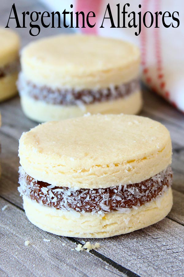 Super soft cornstarch cookies sandwich together with sweet creamy dulce de leche and rolled in coconut flakes. A classic and delicious Argentine snack.