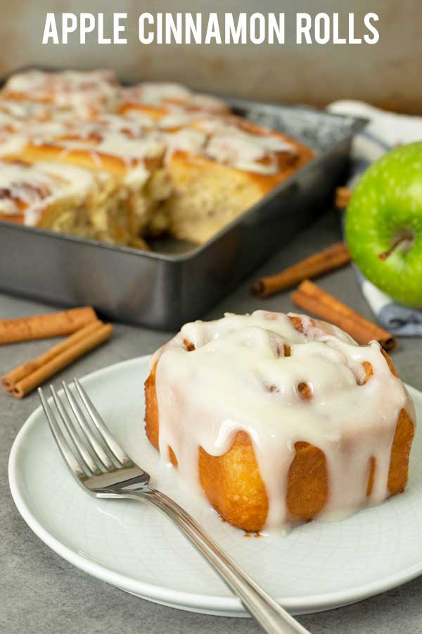 If you love cinnamon rolls then you should really try these apple cinnamon rolls. Soft and fluffy bread with sweet tart soft apple chunks together with heavenly smell cinnamon sugar and covered with creamy cream cheese glaze. #cinnamonrolls #apple #fallbaking #elmundoeats