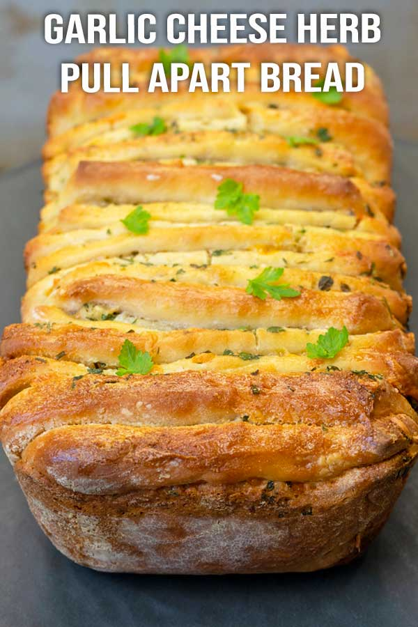 Try this soft, fluffy and full of flavours garlic cheese herb pull apart bread, and you'll never want to buy from the store again. #bread #garlicbread #pullapartbread #cheesebread #elmundoeats