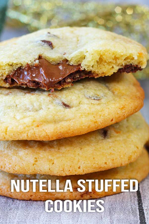 For all the sweet tooth out there, stuffed Nutella cookies with chocolate chips! These are perfect for you! And they're perfect for the holiday too. Delicious! #cookierecipe #nutellacookie #chocchipcookie #holidaycookies #elmundoeats