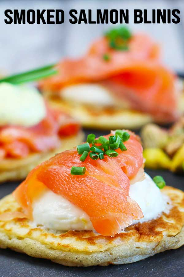 Homemade smoked salmon blinis with parmesan cheese and 2 different flavors of cream cheese. Lemon chives cream cheese and honey mustard cream cheese. These simple appetizers are both beautiful and delicious! #holidayappetizer #blinis #easyappetizer #elmundoeats