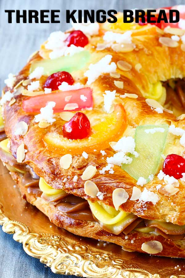 Three Kings bread or rosca de reyes! Soft and fluffy sweet bread filled with custard and Nutella. Yes, 2 flavors. Make and serve this yummy bread on Three Kings day. #roscadereyes #roscon #threekingsbread #breadrecipe #sweetbread #elmundoeats