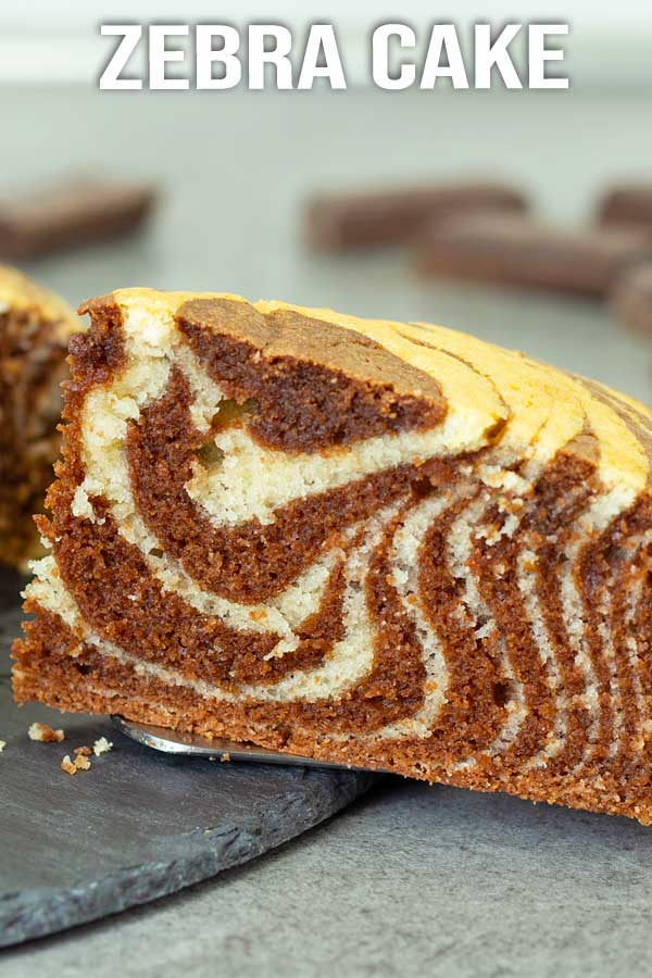 This easy zebra cake is soft and moist. If you can't decide between a vanilla cake and a chocolate cake, make this zebra cake as it has the best of both. #cake #zebracake #chocolatecake #vanillacake #elmundoeats