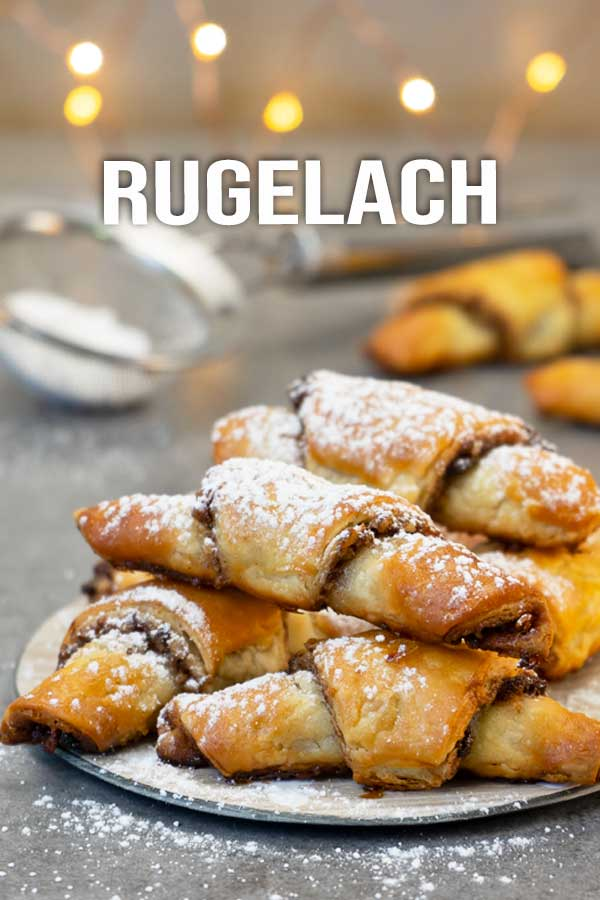 My take on the delicious rugelach, filled with cinnamon sugar, pecans and raisins. Flaky, crispy pastry dough that takes less than a minute to make. #rugelach #cookie #easyrecipe #elmundoeats