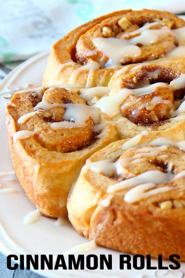 Soft and fluffy rolled bread with sweet cinnamon walnuts filling with cream cheese glaze. That's how I would describe these babies! They're best eaten slightly warm, when all the wonderful tastes are awake! #cinnamonroll #fallbaking #fallrecipes #elmundoeats