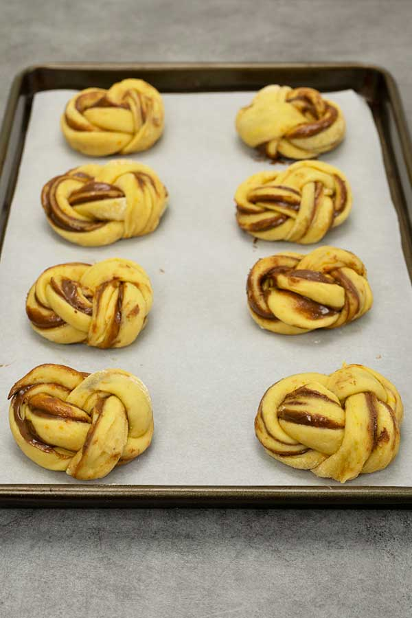 Raw Nutella babka buns on a tray ready to be baked
