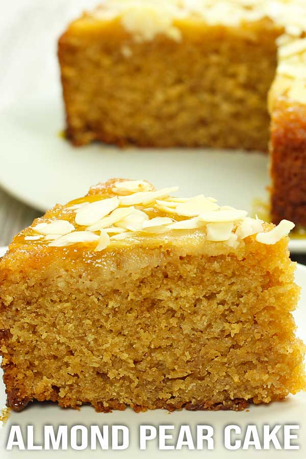 Moist and rich almond and pear cake with a touch of coconut and sprinkled with almond flakes. A perfect cake to bake when you want to impress somebody. #cake #almondcake #pearcake #easyrecipe #elmundoeats