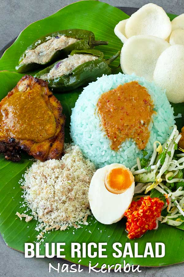 Living outside Malaysia and craving for Nasi kerabu? Try this recipe! I've adapted it for people outside Malaysia who want to enjoy this amazing meal. #nasikerabu #bluerice #malaysianrecipe #elmundoeats