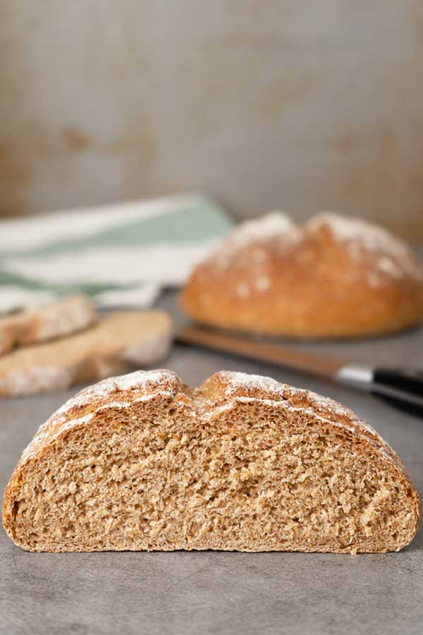 Cut loaf of spelt bread