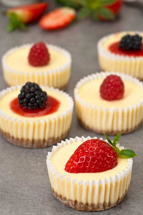 Mini Cheesecakes with berry toppings on a table