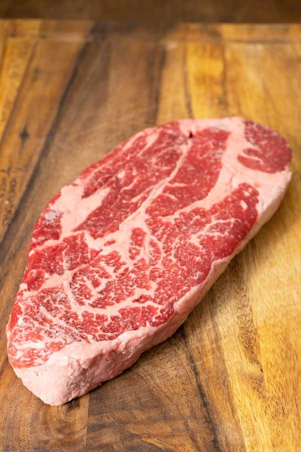rib eye steak for bulgogi on a table