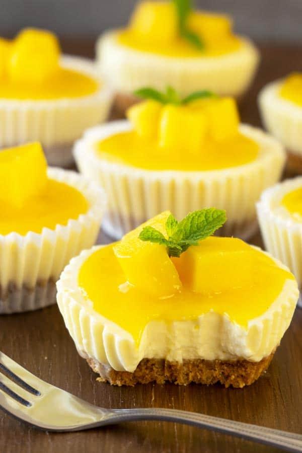 Creamy no bake mini mango lassi cheesecake on a table