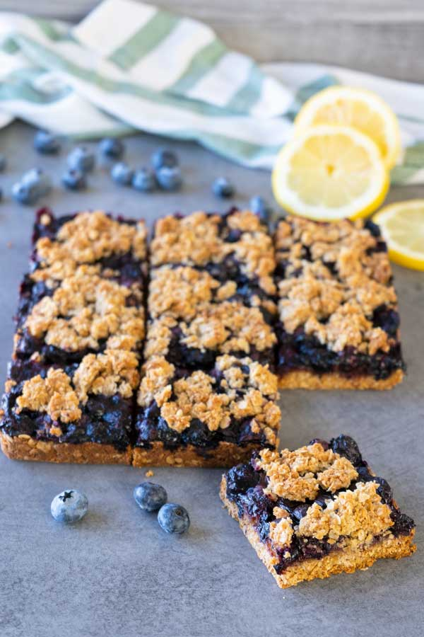 healthy blueberry crumb bars on a table