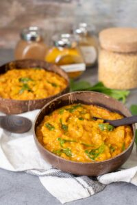 Turmeric Lentil Stew served on two coconut bowls