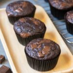 3 Chocolate Banana Muffins on a serving board