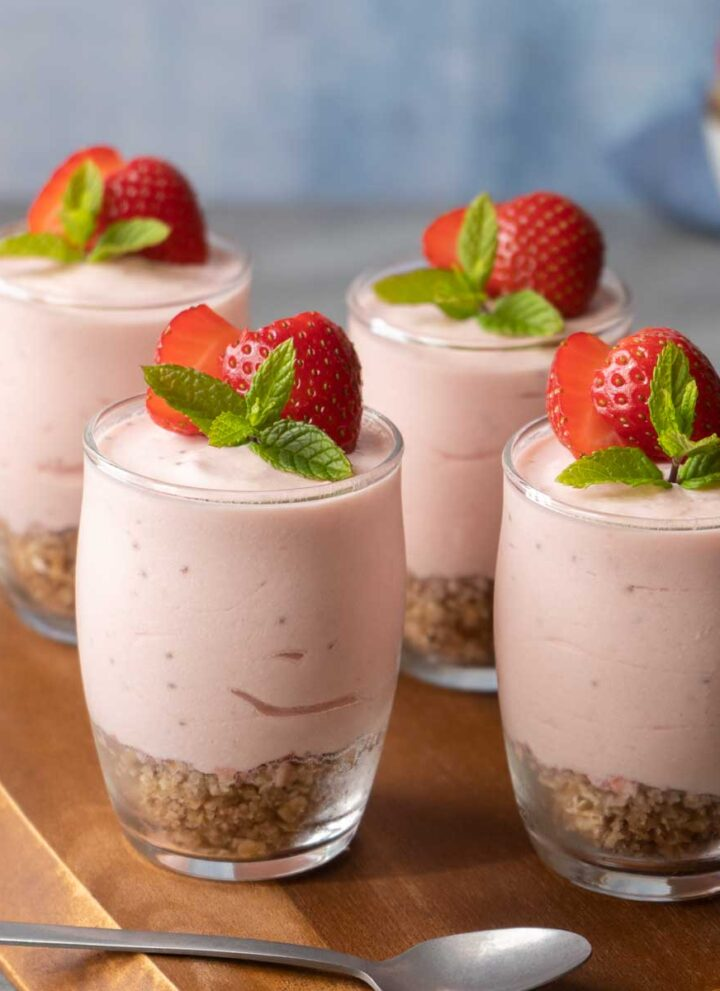 Four Healthier Strawberry Cheesecake Shots on a table