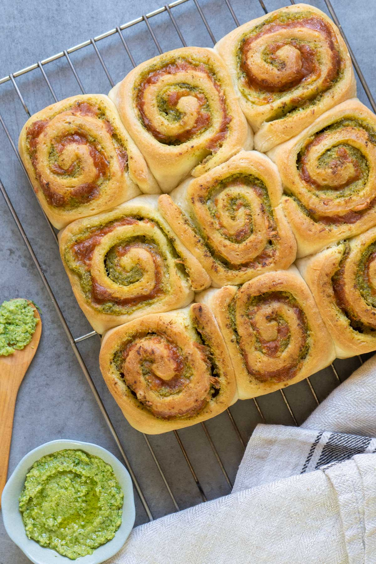 Pesto buns on a cooling rack
