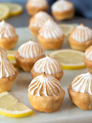 Lemon meringue pie bites on a marble table