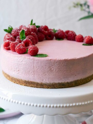 No-Bake Raspberry Cheesecake on a stand plate