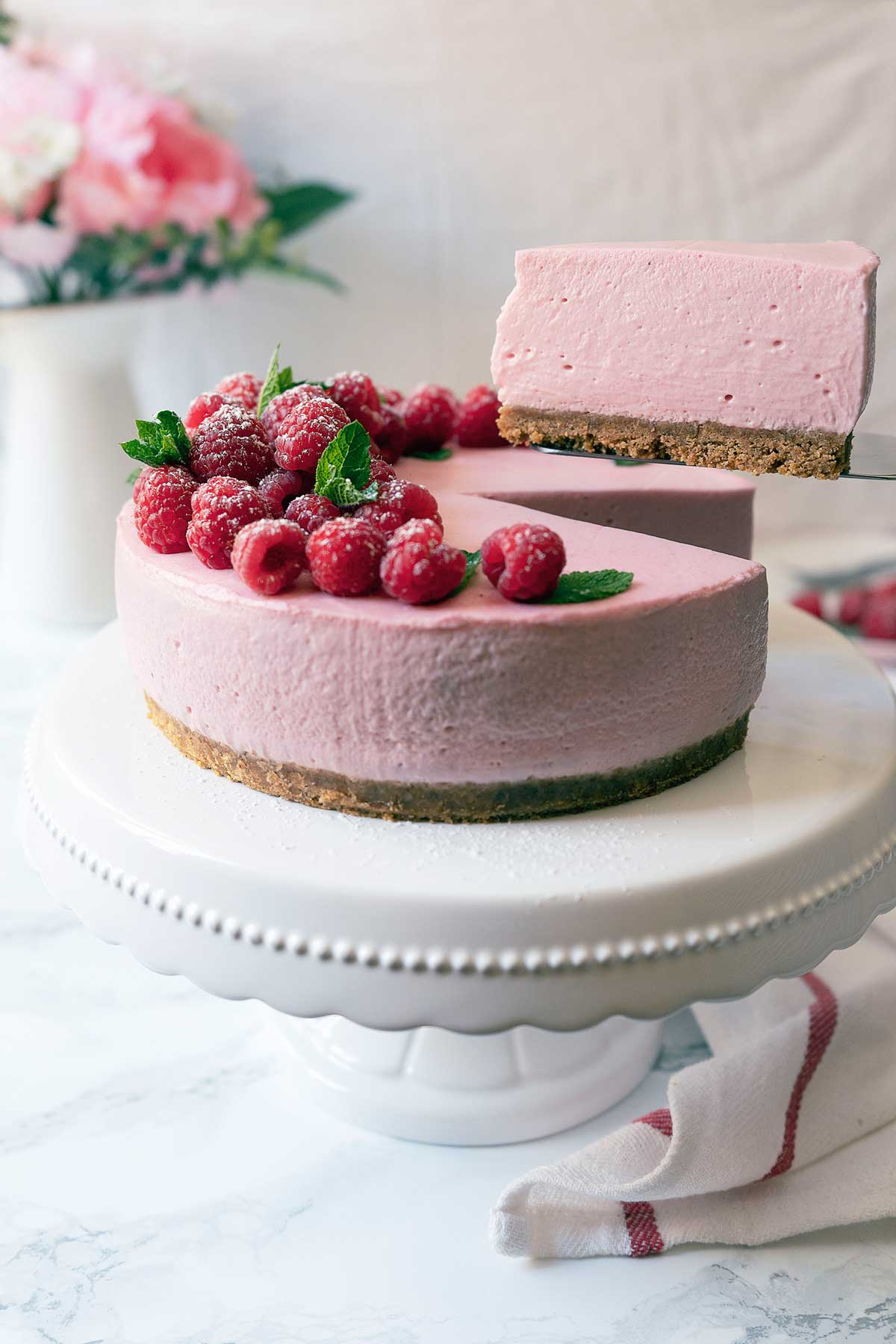 Serving a portion of no-bake raspberry cheesecake