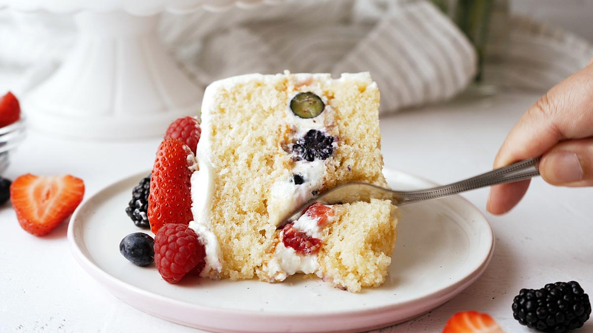 berry cake filled with cream cheese frosting