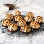 Coconut macaroons on a cooling rack