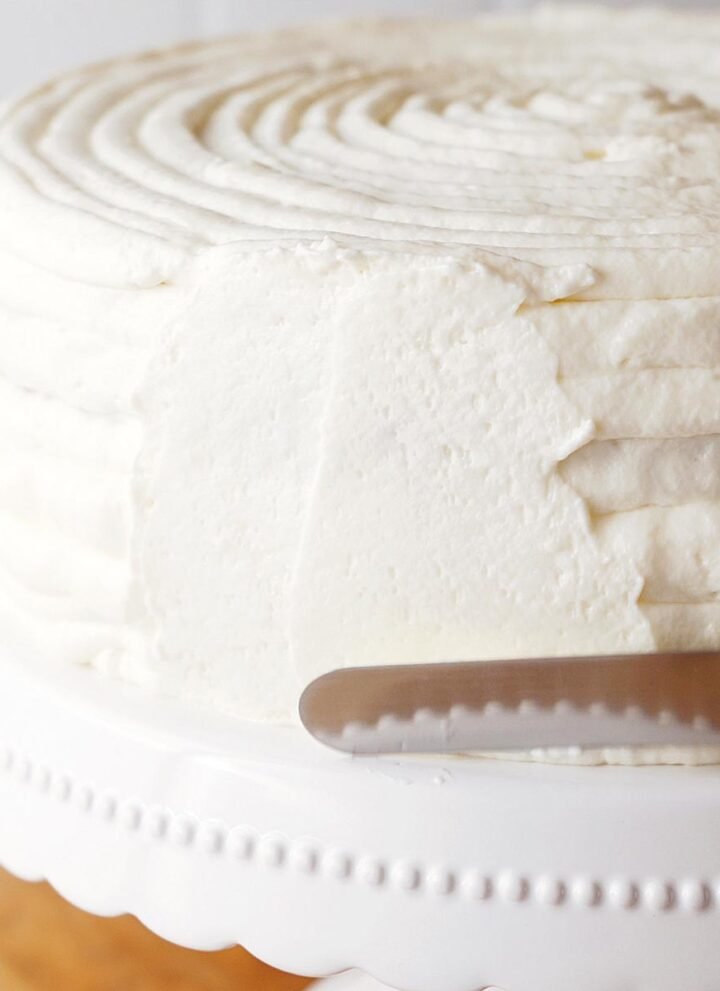 frosting a cake with cream cheese frosting