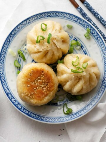 Pan-fried meat buns on a plate