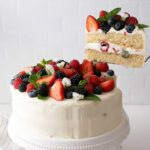 Summer berry cake being served