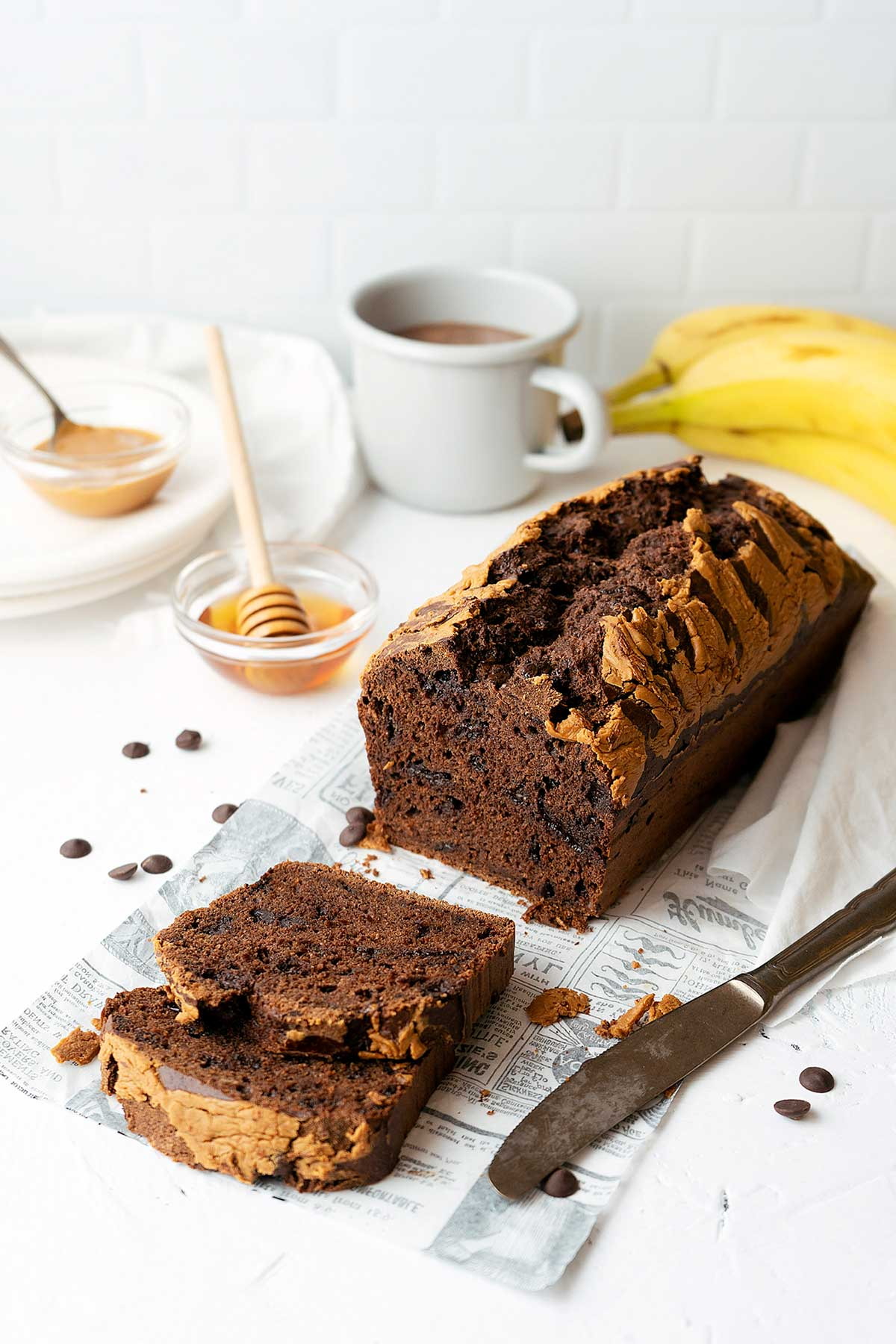 a cut chocolate banana bread loaf