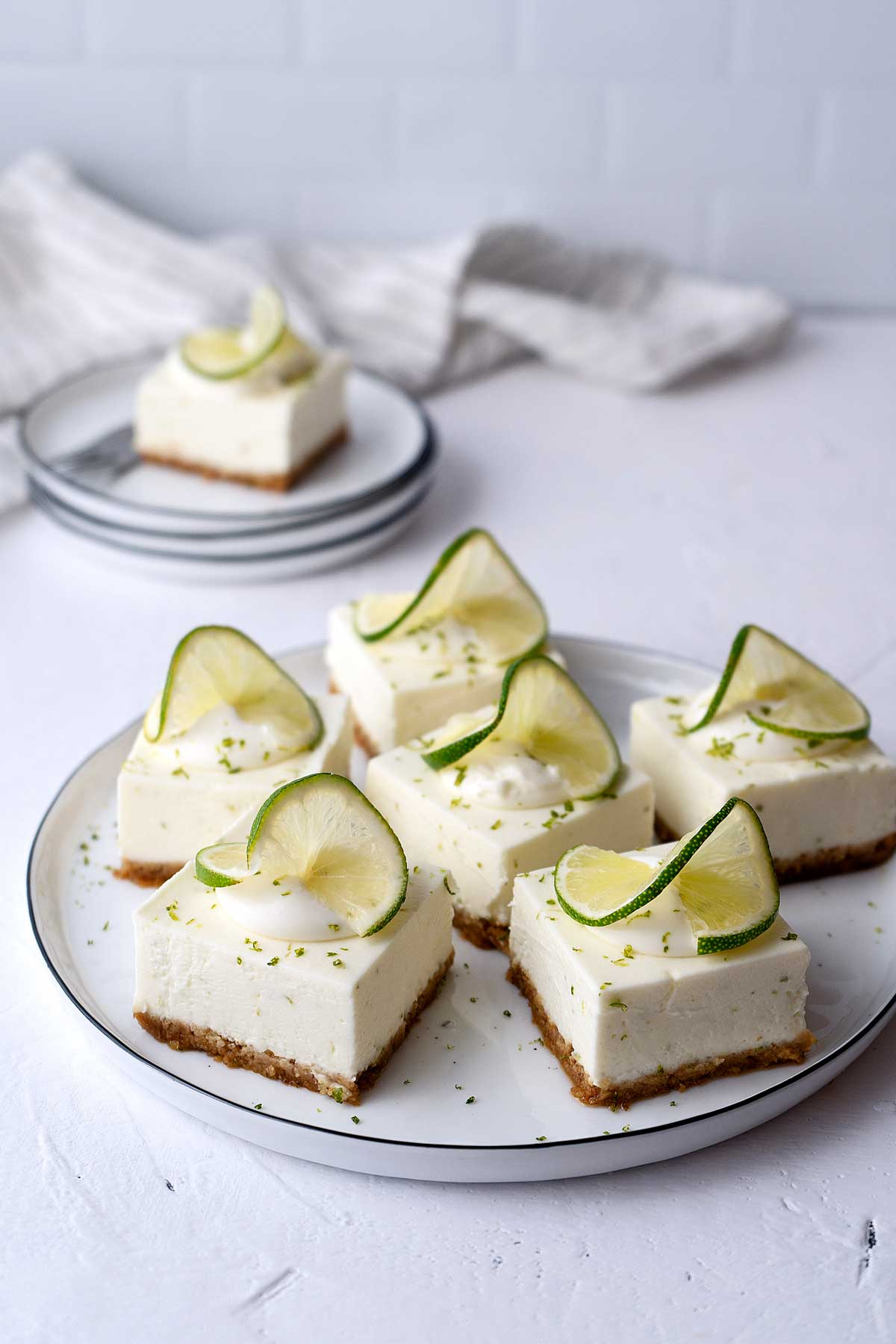 Key lime cheesecake bars served on a plate