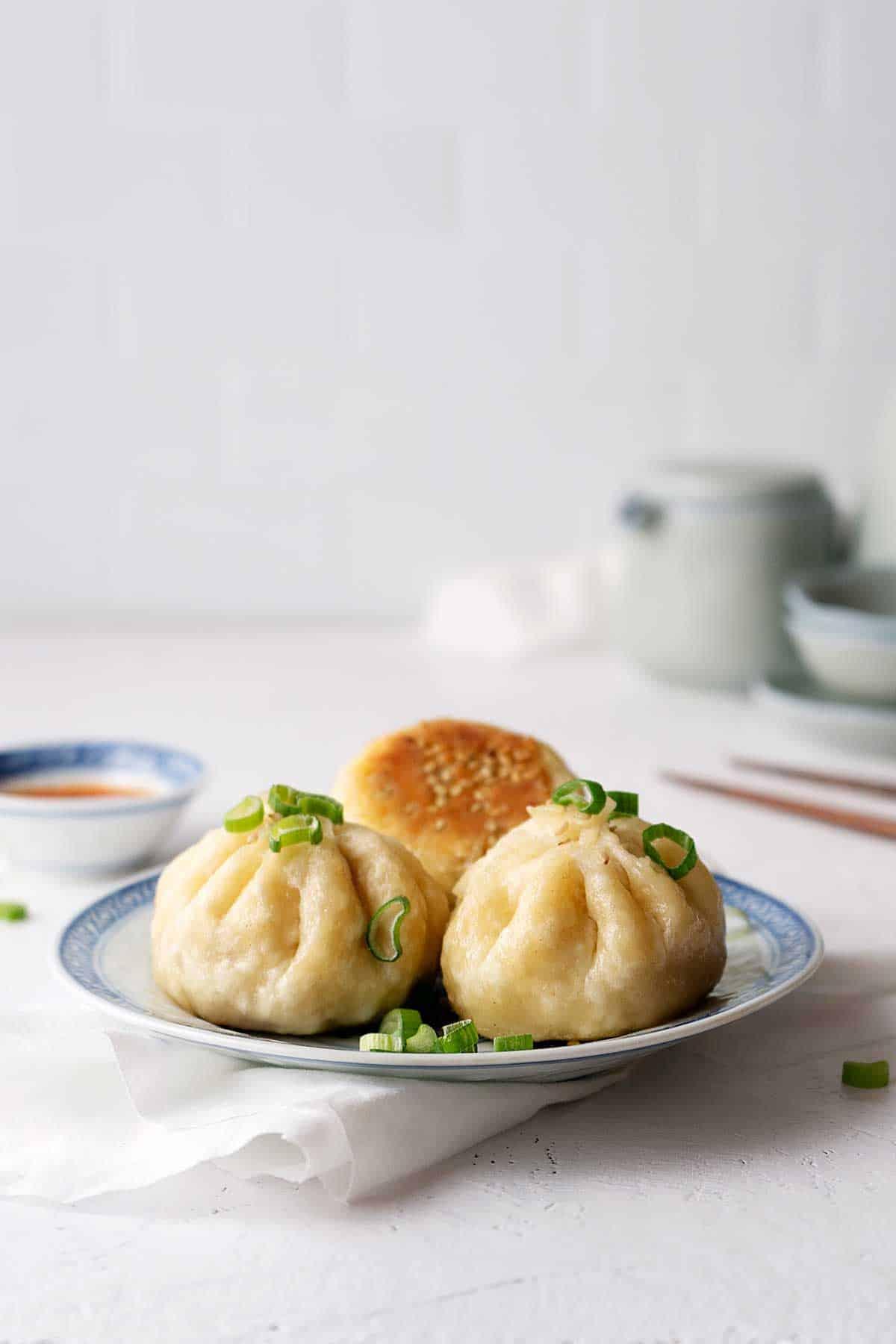 Pan-fried baozi on a plate