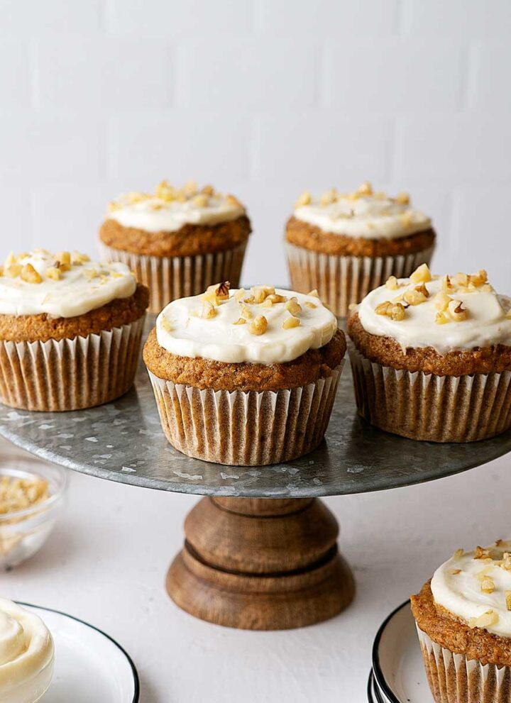 healthy carrot cake muffins on a serving stand