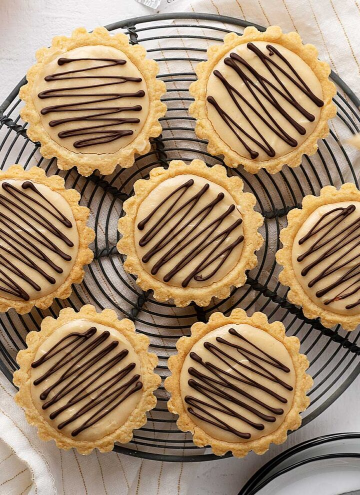 overhead view peanut butter cheesecake tarts.