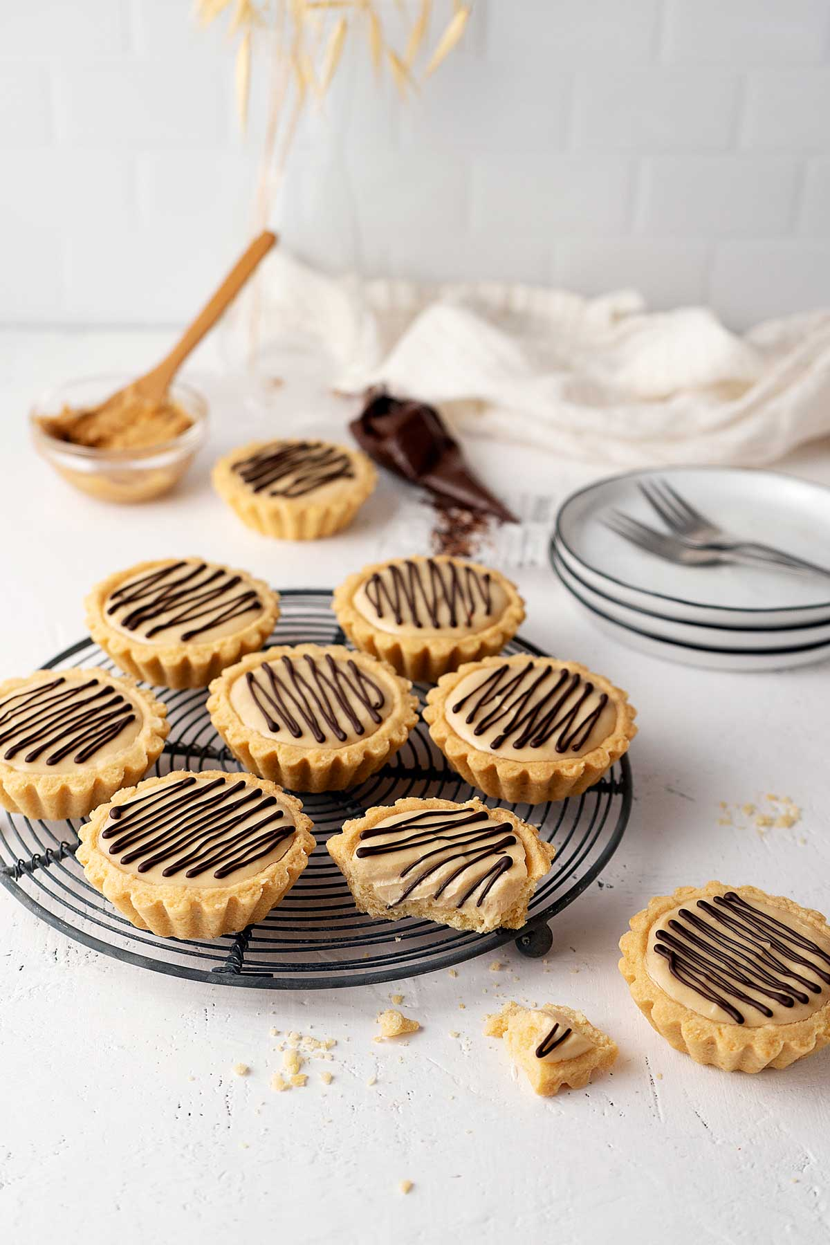peanut butter tarts on a cooling rack.