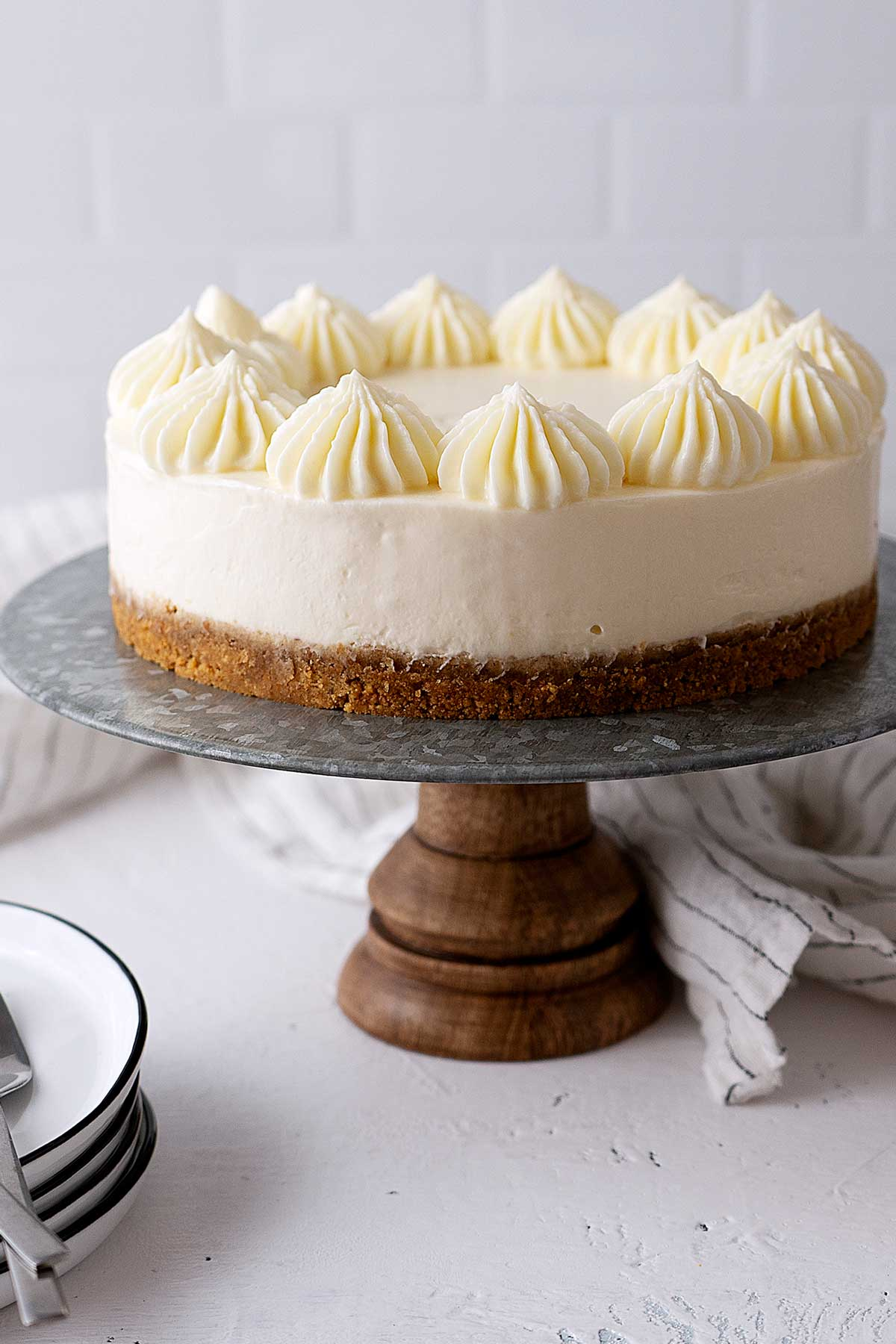vanilla cheesecake on a cake stand
