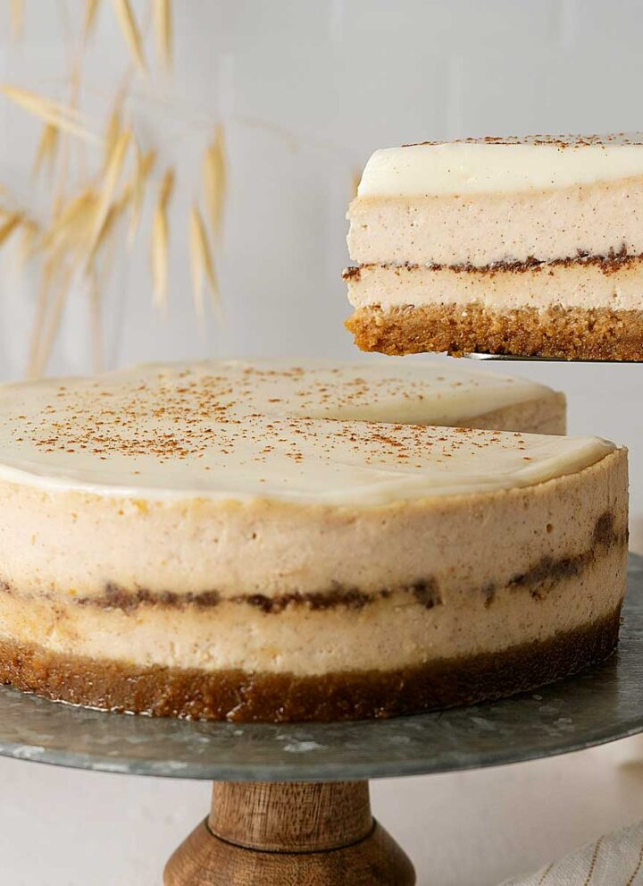 serving cinnamon roll cheesecake.