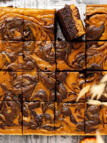 Overhead view pumpkin cheesecake brownies.