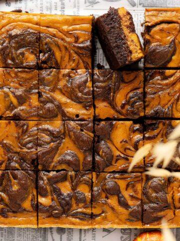 Overhead view pumpkin cheesecake brownies.