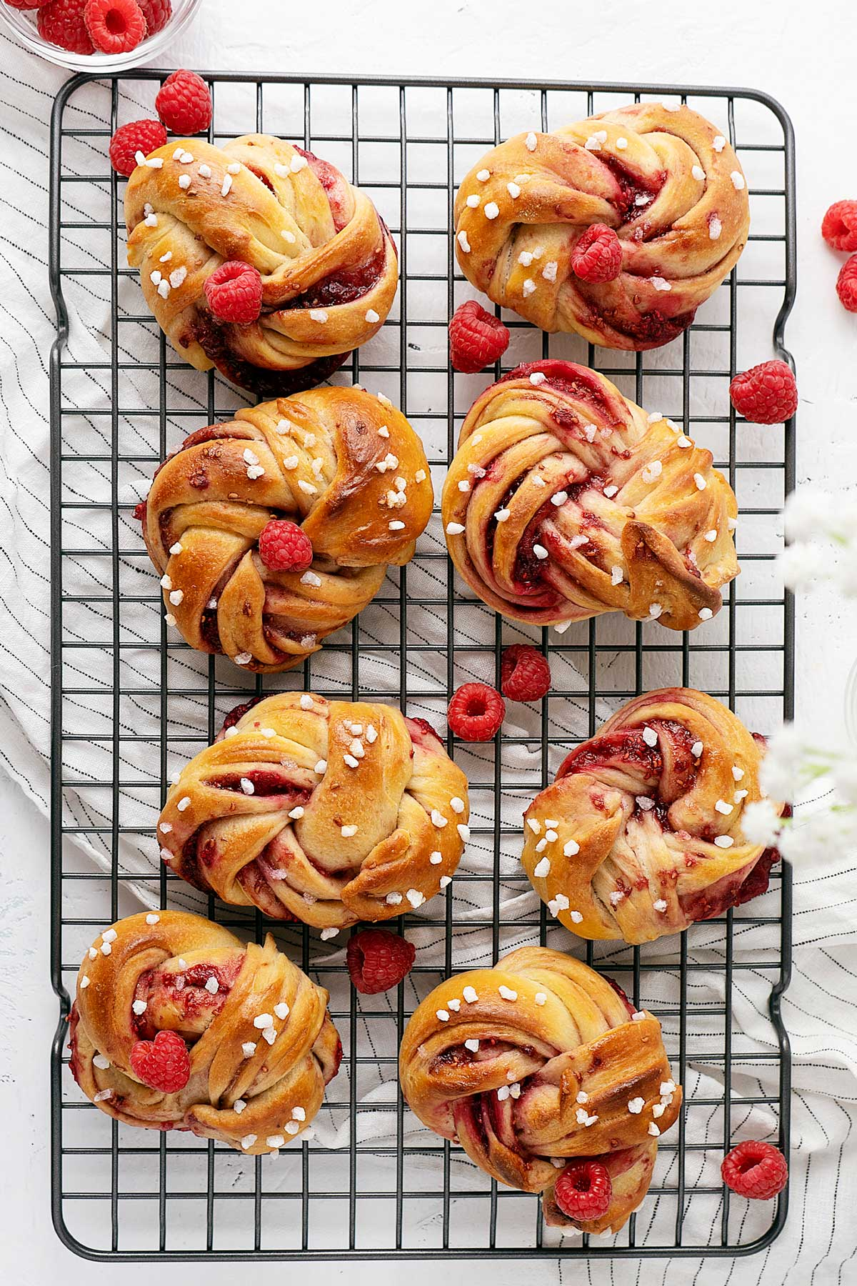 overhead view raspberry twisted buns.