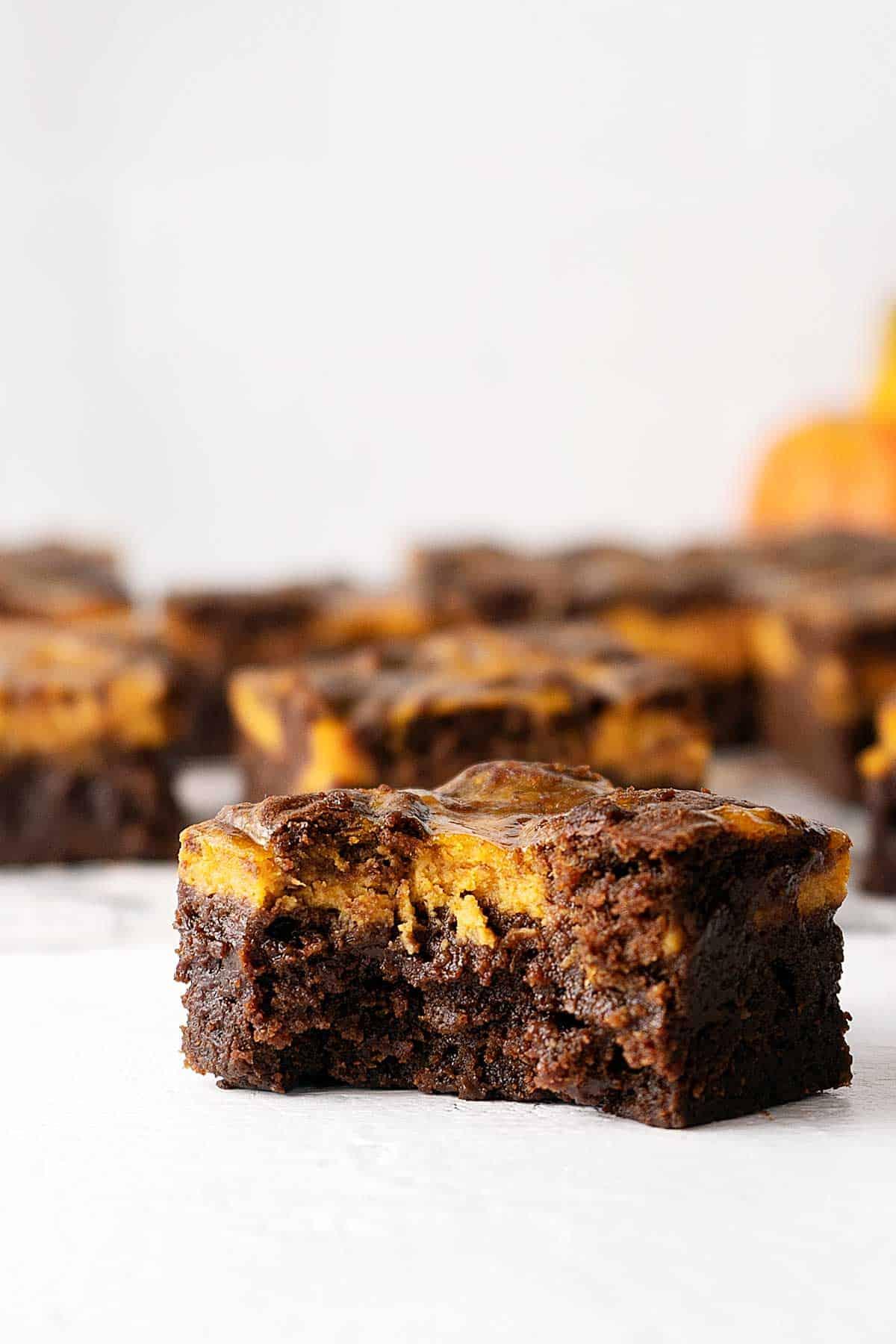 bitten pumpkin cheesecake brownie.
