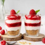 Two Raspberry Cheesecake Shots on the table