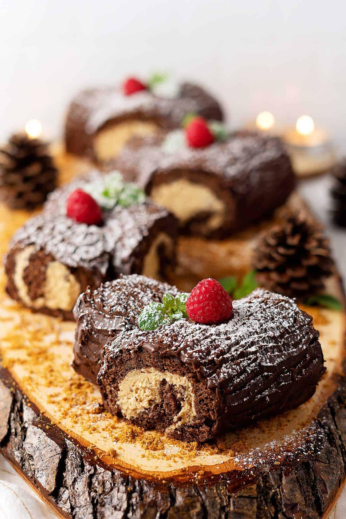 Four Mini Bûche de Noël on a log serving tray.
