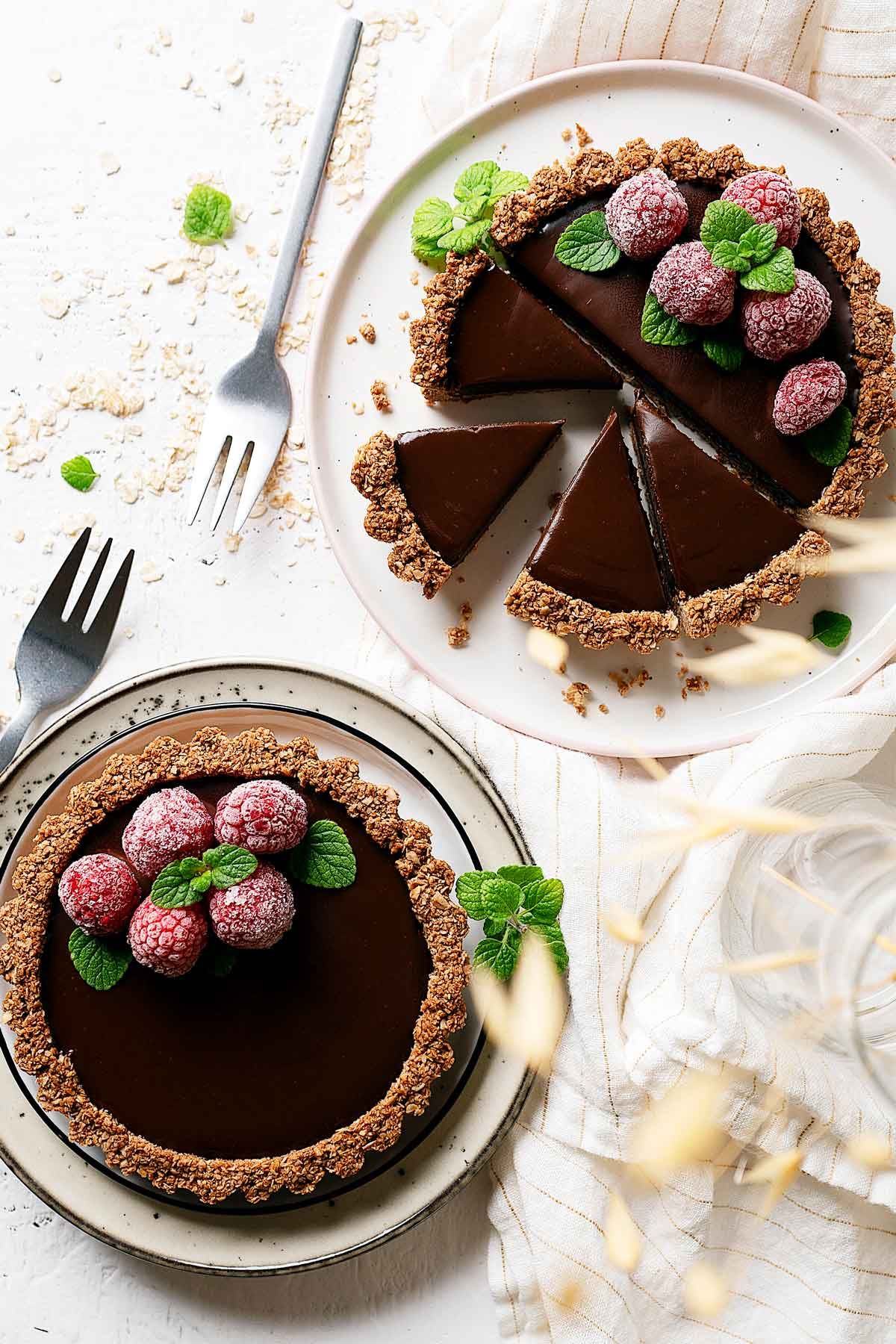 Healthy chocolate coconut tarts sliced view from top with 1 tart whole