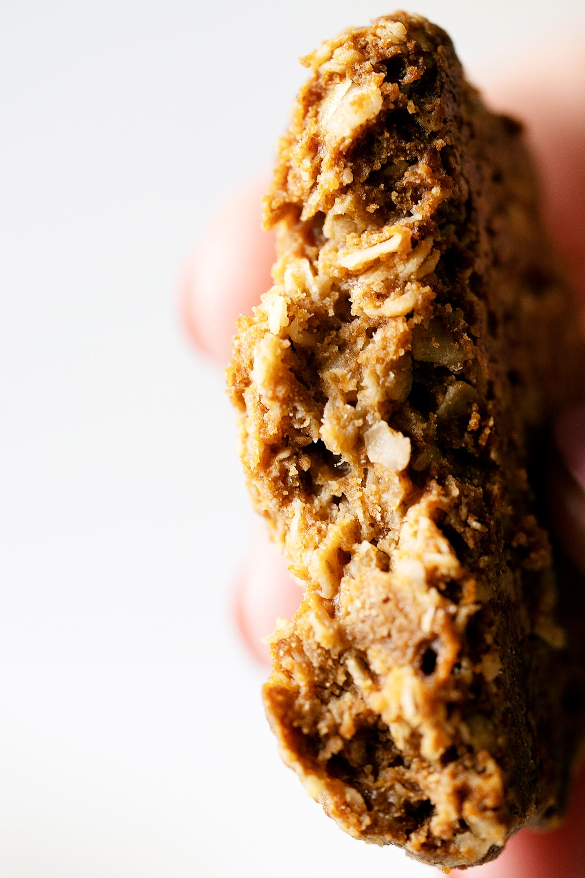 Showing the inside texture of one healthy tahini cookie